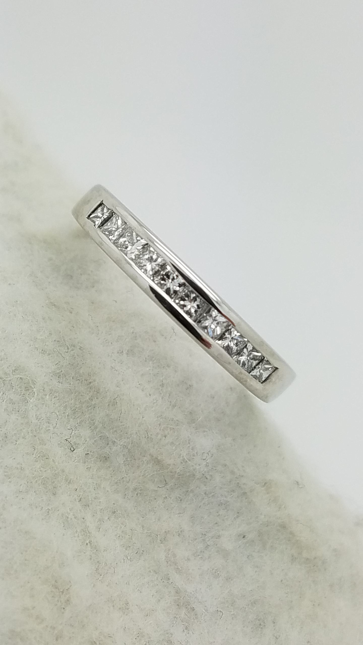 Platinum		0.30	ct	PRINCESS	Cut		Diamond	channel-set	Anniversary Band	Ring