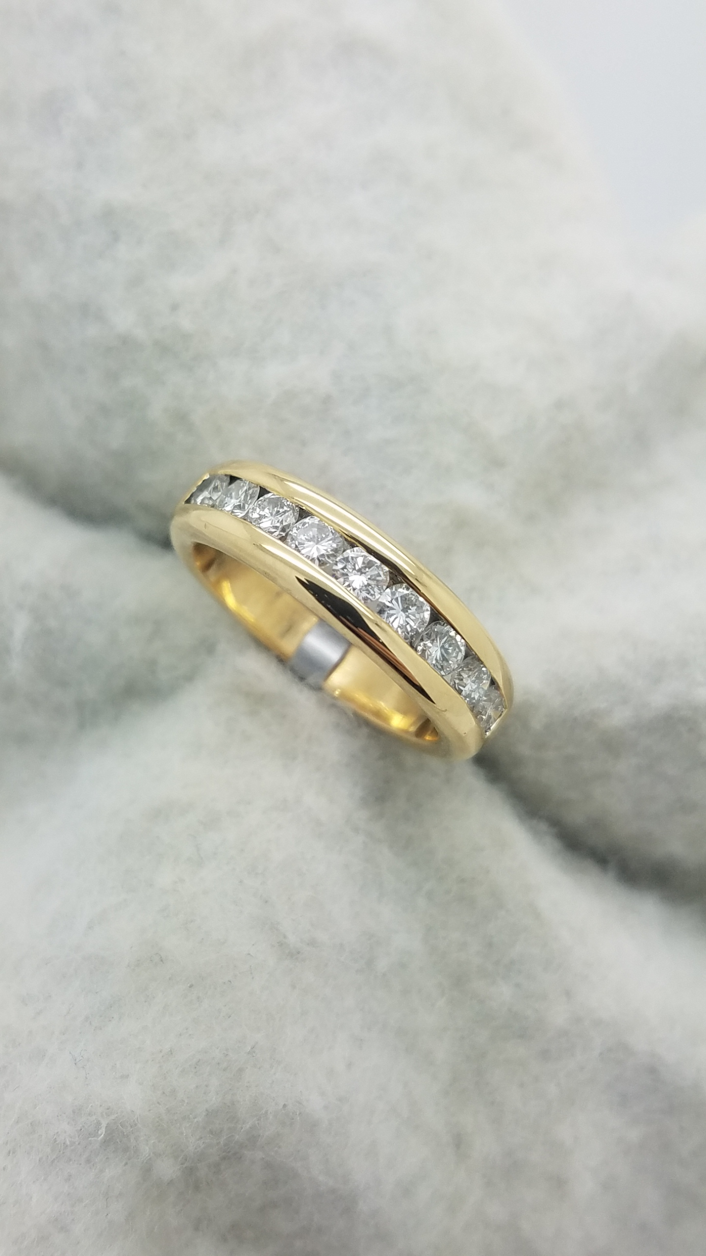18K        Yellow Gold                0.75        ct        Round        Cut                Diamond        channel-set        Anniversary Band        Ring