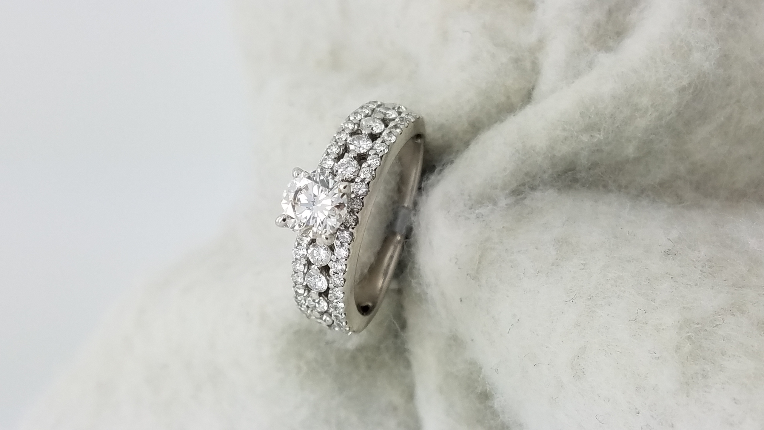 14KWhite GoldLace style mounting.57 + .65ct.RCutDiamondHVS24-prong/paveSolitaire with AccentsEngagement-Ring