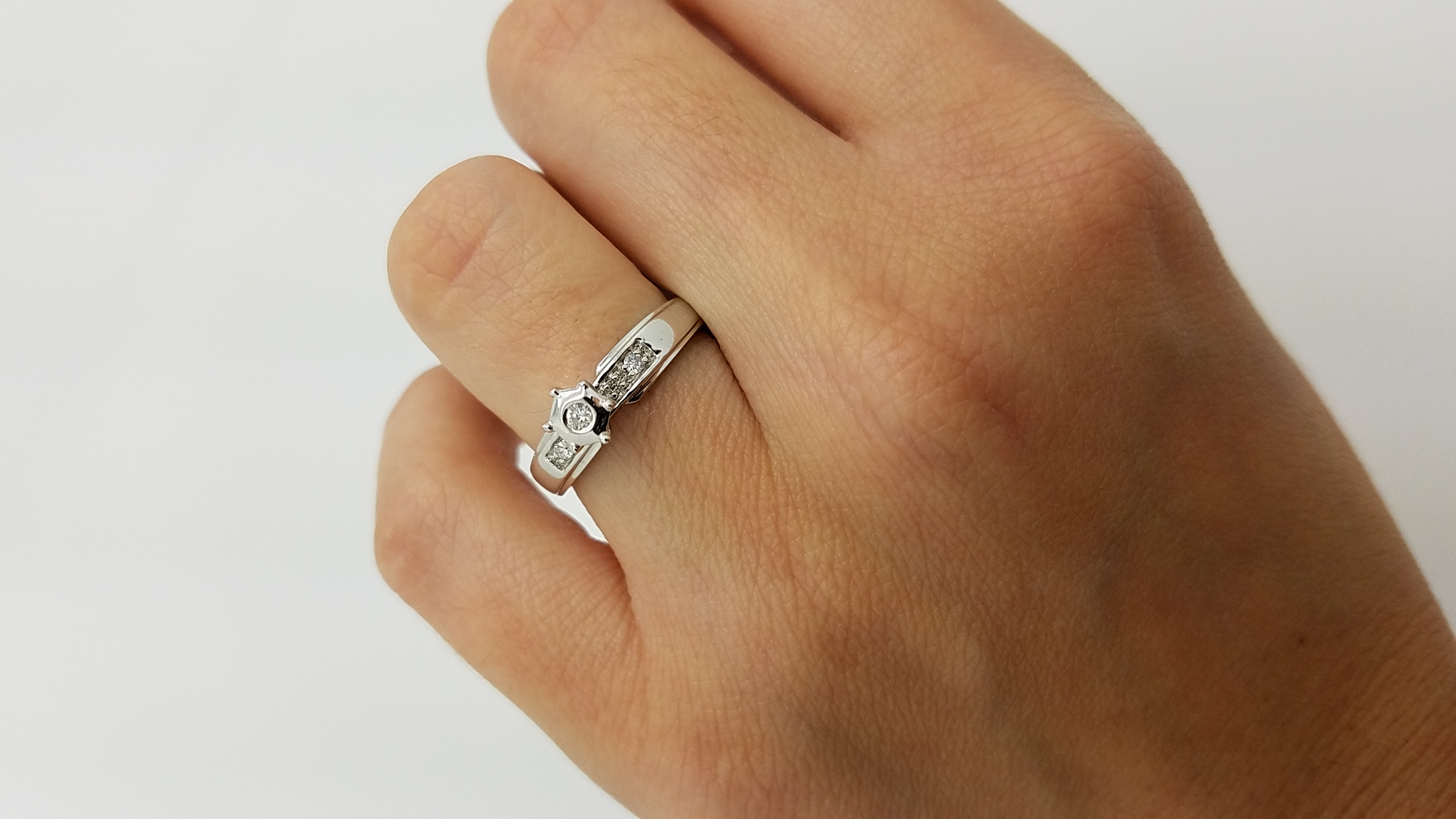 14K        White Gold        ilussion         0.08        ct.        ROUND        Cut        Diamond        Bezel-Set        Solitaire with Accents                Engagement-Ring