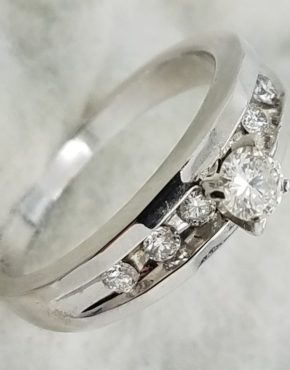 14K	White Gold	chanel band 	0.45	ct.	Round		Cut	Diamond	4-prong	Solitaire with Accents		Engagement-Ring